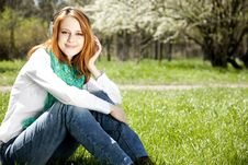 Girl With Headphone In The Park. Stock Photo