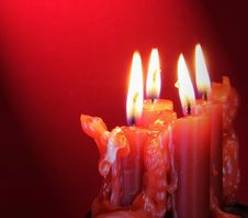 Free Burning Candles With Light Directed On Them Royalty Free Stock Photography - 19276667