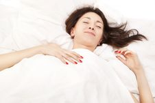 Portrait Of A Brunette In Bed Stock Photo