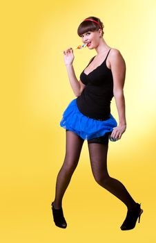 Free Beauty Woman With Lollipop Smile You On Yellow Royalty Free Stock Photography - 19282647