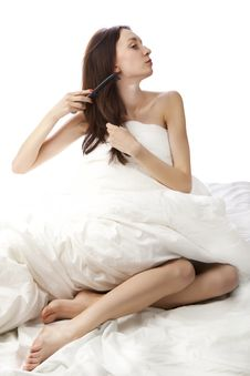 Portrait Of A Brunette In Bed Royalty Free Stock Image