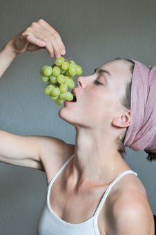 Woman Eating Grape Stock Images
