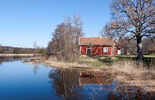 Swedish Red  House At A Lake. Stock Photos
