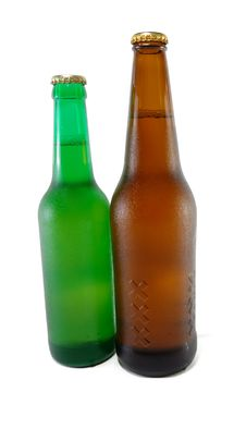 Two Bottles Of Beer With Different Capacities Royalty Free Stock Photography