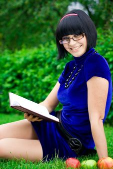 Happy Woman With Book Outdoors Stock Image