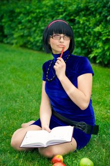 Happy Woman With Book Outdoors Stock Photography