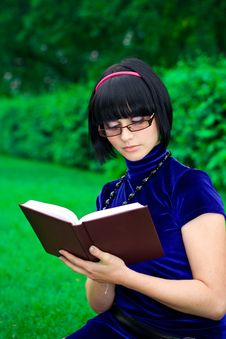 Happy Woman With Book Outdoors Royalty Free Stock Photos