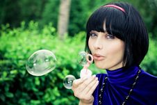 Free Woman Blowing Bubbles Stock Photo - 19286950