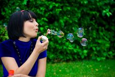 Free Woman Blowing Bubbles Royalty Free Stock Image - 19286956