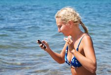 Free Girl With The Phone Against The Sea Stock Photography - 19287492