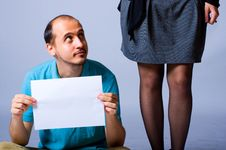 Free Man With A White Paper Looking At A Woman Royalty Free Stock Photos - 19288308