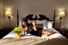 Free Beautiful Woman On Hotel Bed With Flowers Royalty Free Stock Image - 19289856