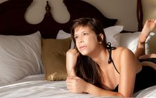 Pretty Pensive Woman On Bed Royalty Free Stock Images