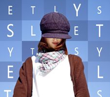 Girl With Scarf And Purple Cap Stock Photo