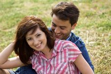 A Young Couple In Love In A Park Royalty Free Stock Photos