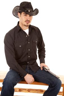 Free Cowboy Sitting With Gun On Leg Stock Photo - 19292460
