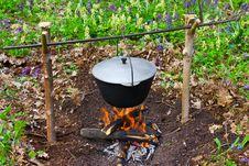 Preparing Food On Campfire Stock Photo