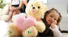 Free Girl Is Hugging Big Bear Royalty Free Stock Photos - 19295478