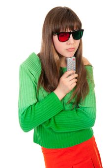 Free Girl Wearing 3D Glasses Holding Remote Control Royalty Free Stock Photography - 19296007