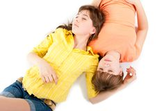 Two Teen Girls Lie Side By Side Royalty Free Stock Image