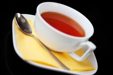 Tea Cup And Tea Spoon On Black Background Stock Photo
