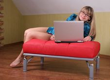 Free Girl With Laptop On Red Sofa Royalty Free Stock Photo - 1934575