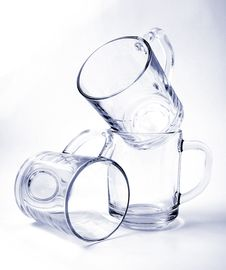 Three Empty Glass Mugs Royalty Free Stock Images