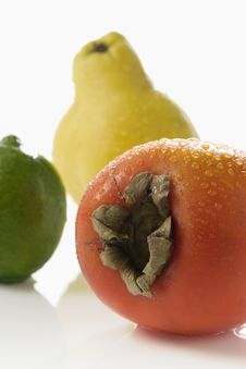 Free Persimmon Lime And Quince Stock Photography - 1937542