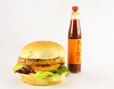 Huge Hamburger With Hot Sauce Stock Image