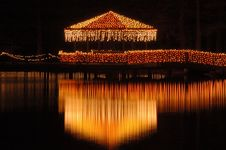 Free Lakeside Cabana Covered In Lights Royalty Free Stock Photos - 1939038