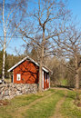 Free Stone Wall And A Typical Red House In Sweden. Royalty Free Stock Images - 19303739