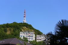 Telecommunication Tower And Buildings In Mountains Royalty Free Stock Image