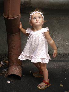 Free Toddler Girl And Rainwater Pipe Royalty Free Stock Photos - 19308388