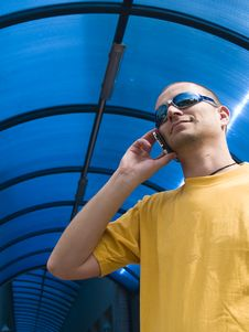 Free Man Talking On The Phone, Yellow And Blue Stock Photography - 19308402