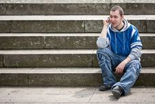 Young Man Sitting On Stairs Stock Photography