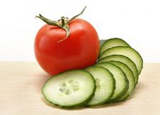 Free Cucumber And Tomato On A Wooden Board Royalty Free Stock Images - 19310189