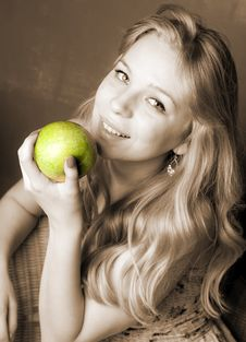 Free Smiling  Pretty  Blond  Girl  With Apple Royalty Free Stock Image - 19313196