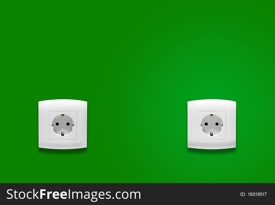 Electric outlet on green wall
