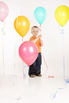 Young Boy With Balloons Royalty Free Stock Photography
