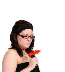Free Beautiful Young Woman Admiring A Flower Closeup Stock Photography - 19324842