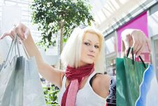 Portrait Of Woman At The Mall With Bags Copyspase Royalty Free Stock Images