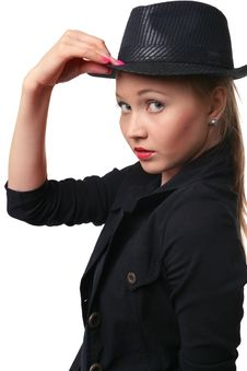 Beautiful Young Woman Holds Her Hat Bolder. Stock Photography
