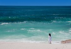 Girl Standing On The Tropical Beach Stock Photography