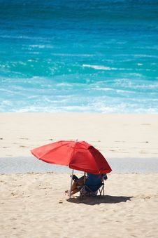 Free Beach Scene With Red Umbrella And Blue Water Stock Images - 19327714