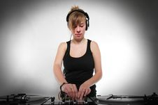 Free Young Girl DJ Mixing Music Royalty Free Stock Photography - 19331977