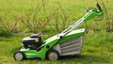Free Lawn Mower On Fresh Cut Grass Royalty Free Stock Photos - 19334458