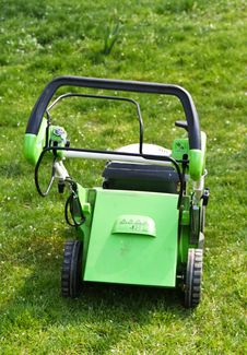Lawn Mower On Fresh Cut Grass Stock Image