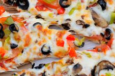 Taking Slice Of Pizza Stock Photography