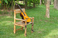 Free Guitar On Old Rocking Chair On Grass Stock Photo - 19346190