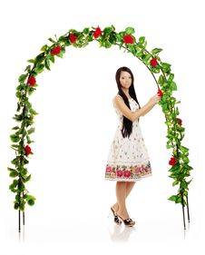 Cute Girl Near The Arch Entwined By Roses Stock Image